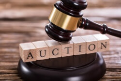 Close-up Of A Gavel Striking On Auction Word